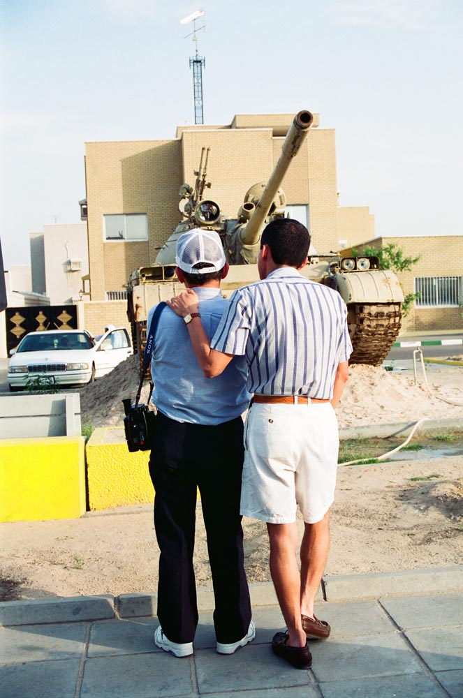 Al-Qurain House Exterior in 1993  Fathers of two American soldiers killed during the Gulf War share an emotional moment as they look at one of the Iraqi tanks that fired on the house. The tank's gun still points at the house. Nicolas Fajardo of New York is on the left. (See also Overview pages 35-36.)