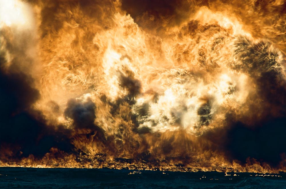 Oil Well Fire and Burning Oil Lake  Close-up of flames. Oil that spilled from burning exploded wells formed lakes that often caught fire.