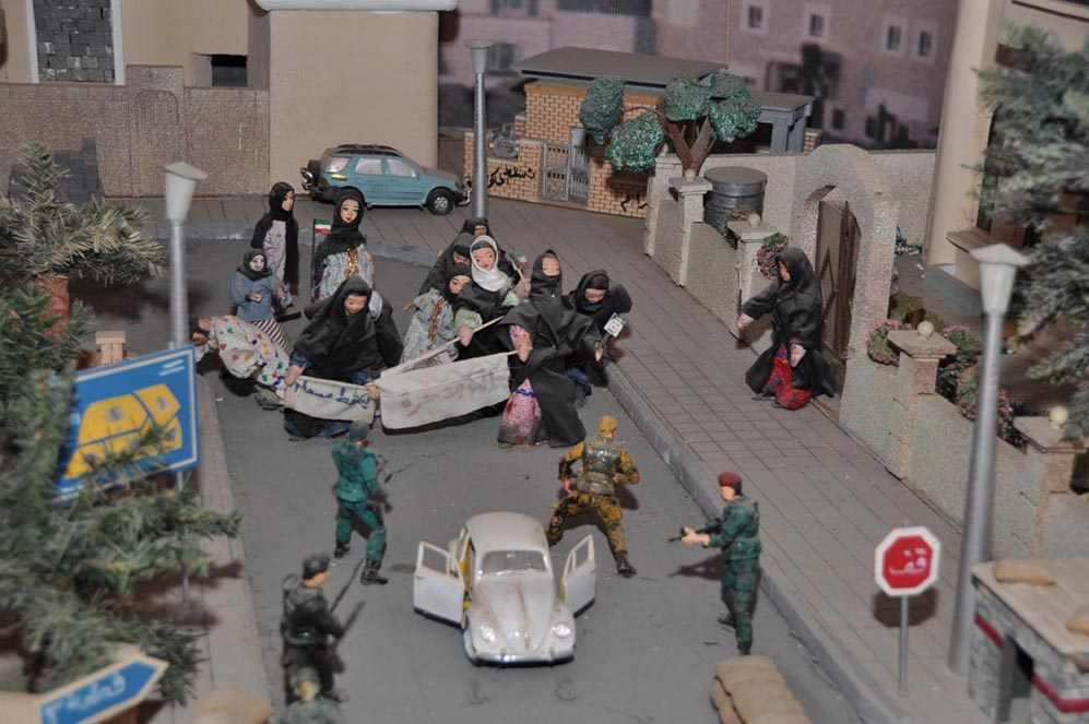 Demonstration Against Iraqi Occupation  Kuwaiti women marched during the early days of the occupation. The Iraqi troops soon cracked down on dissent and it became too dangerous to continue opposition in public. Resistance now had to move underground. (See also .) (diorama from Bait Al-Watani, the Kuwait National Memorial Museum)